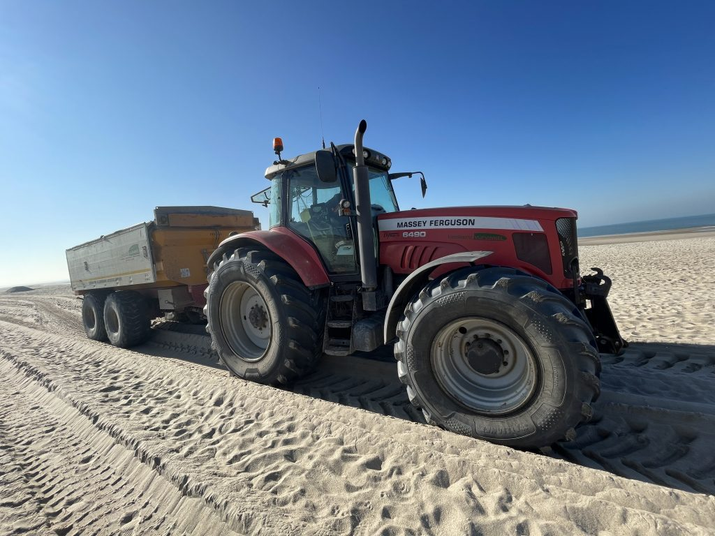 The other 30-40% of time the tractor spends on the beach unloading the sand back to the coast